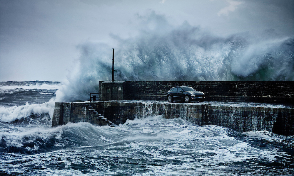 Porsche Macan on a cob with wave crashing against the cob wall surrounded by stormy seas Ray Massey is an established, award winning, UK professional  photographer, shooting creative advertising and editorial images from his stunning studio in a converted church in Camden Town, London NW1. Ray Massey specialises in drinks and liquids, still life and hands, product, gymnastics, special effects (sfx) and location photography. He is particularly known for dynamic high speed action shots of pours, bubbles, splashes and explosions in beers, champagnes, sodas, cocktails and beverages of all descriptions, as well as perfumes, paint, ink, water – even ice! Ray Massey works throughout the world with advertising agencies, designers, design groups, PR companies and directly with clients. He regularly manages the entire creative process, including post-production composition, manipulation and retouching, working with his team of retouchers to produce final images ready for publication.