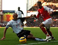 Photo: Javier Garcia/Back Page Images<br />Arsenal v Fulham, FA Barclays Premiership, Highbury, 26/12/04<br />Gael Clichy skips past Zesh Rehman