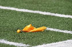 Football ref's infraction flag lying on field