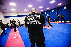 Graduate Level programme t-shirt. Stef Noij, KMG Instructor from the Institute Krav Maga Netherlands, kicking during the IKMS G Level Programme seminar today at the Scottish Martial Arts Centre, Alloa.