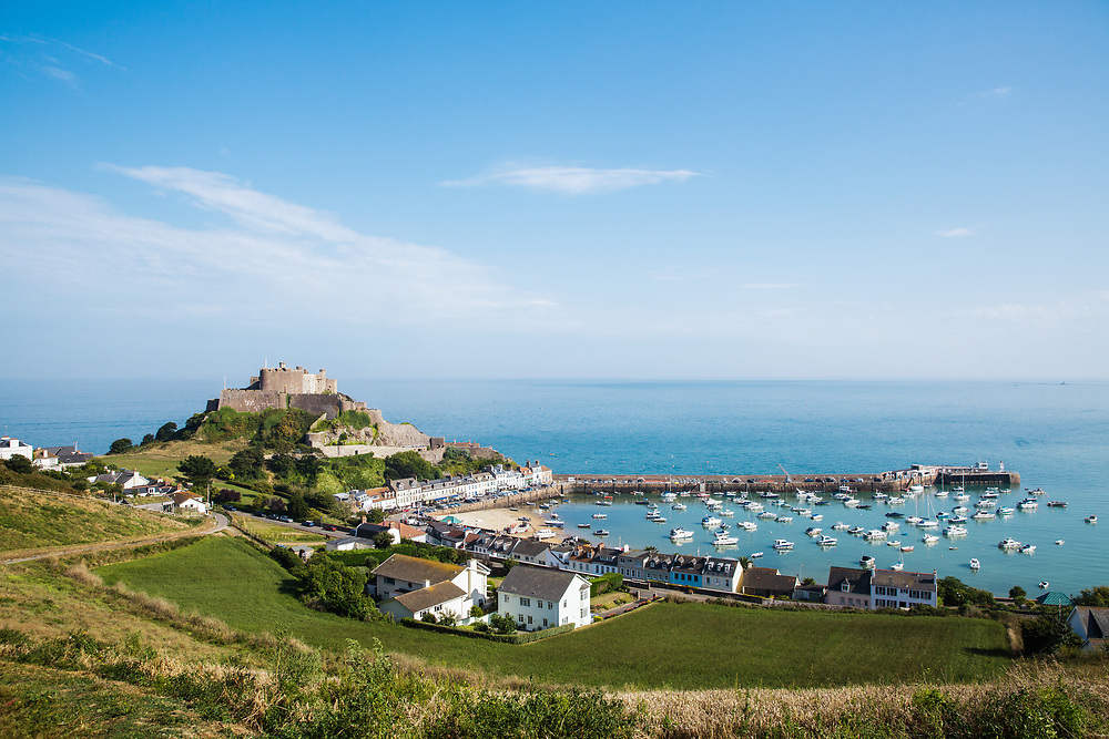View of Mont Orgueil Castle and harbour, a popular tourist destination and historic site, in Jersey, Channel Islands