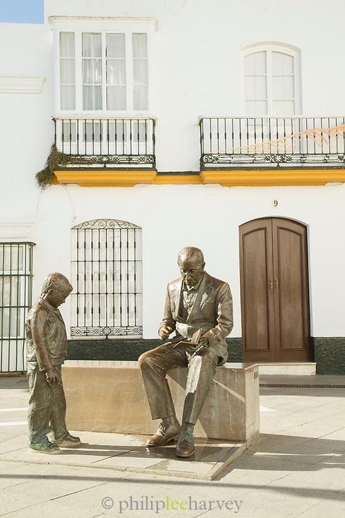 Statue of boy and man in Plaza de Espana in Cobil de la Frontera, Spain