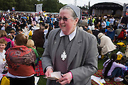Sister Bernadette, Head Teacher of Viego Fedelis in Sth London awaits arrival of Hyde Park rally of Pope during Pope Benedict XVI's papal tour of Britain 2010, the first visit by a pontiff since 1982. Taxpayers footed the £10m bill for non-religious elements, which largely angered a nation still reeling from the financial crisis. Pope Benedict XVI is the head of the biggest Christian denomination in the world, some one billion Roman Catholics, or one in six people. In Britain there are about five million Catholics but only a quarter of Catholics regularly attend Sunday Mass and some churches have closed owing to spending cuts.