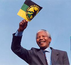 Nelson Mandela waving the ANC flag in 1993.