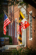 USA, Annapolis, Maryland. Flags of the United States and State of Maryland outside a government building.