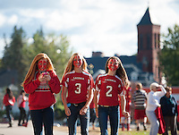 "Laconia ""Pride"" on the faces of LHS students marching in the Homecoming parade Friday afternoon.  (Karen Bobotas/for the Laconia Daily Sun)"
