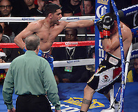 DEC 15,2012. LOS ANGELES,CA. USA. Dec 15,2012. (in blue trunks) .Amir Khan went 10 rounds with Carlos Molina Saturday night in the main event at the Sports Arena. Khan, as expected, dominated Molina and stopped him after the 10 th of 12 rounds in front of 6,109 boxing fans..Referee Jack Reiss called a halt to the bout on the advice of Molina's corner, with Khan getting credit for a 10 th-round technical knockout. There were no knockdowns and Khan was ahead by nine points on all three scorecards. Photo by Gene Blevins/LA Daily News.