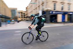 Glasgow, Scotland, UK. 1 April, 2020. Effects of Coronavirus lockdown on Glasgow life, Scotland. Deliver delivery man on bike rides past Sauchiehall Street.