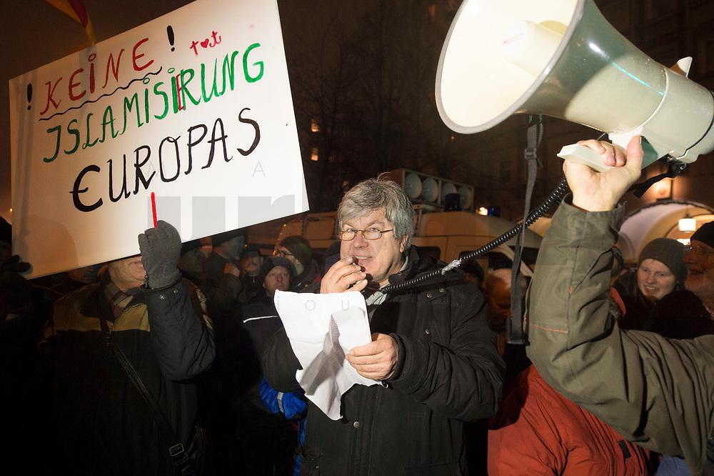 """05 JAN 2015, BERLIN/GERMANY:<br /> Dr. Karl Schmitt (M), vom Verein """"Patrioten"""", Anmelder der Bärgida-Demo """"Berliner Patrioten gegen die Islamisierung des Abendlandes"""", haelt mit Hilfe eines Megafons eine Rede, Baergida Demo, Spandauer Strasse<br /> IMAGE: 20150105-01-058<br /> KEYWORDS: Bärgida, Demonstranten, Protest, Demonstration,"""