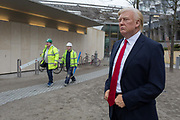 The waxwork of Donald Trump stands outside the US Embassy at Nine Elms in south London on the day when the President announced on Twitter, his refusal to visit London and open the new state premises after its historic move from Grosvenor Square, on 12th January 2017, in London, England. The waxwork is the property of Madame Tussauds and took a team of 20 artists 4 months to create, going on display on the day of his innauguration in 2017. It is valued at £150,000.