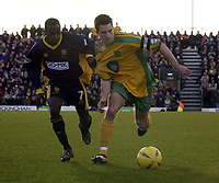 Picture: Henry Browne.<br />Date: 07/02/2004.<br />Wimbledon v Norwich City.<br /><br />Adam Drury of Norwich is held by Dons Jamal Campbell Ryce.