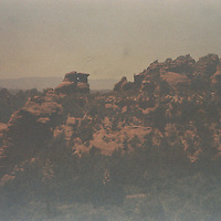 """1. When was this photo taken?<br /> <br /> Maybe 25 years ago, c. 1992<br /> <br /> 2. Where was this photo taken?<br /> <br /> Probably Schnebly Hill Road near Sedona, AZ<br /> <br /> 3. Who took this photo? <br /> <br /> William Latshaw<br /> <br /> 4. What are we looking at here? <br /> <br /> I believe it's a view down Schnebly Hill Road from my campsite. This was before the area was regulated & you could free-camp anywhere.<br /> <br /> 5. How does this old photo make you feel?<br /> <br /> I had recently left the business world and was on a vision quest. It was an exciting and uncertain time. I was trying to decide where to live, and was considering intentional communities (aka communes...). I had some apprehension around living in such close quarters with 'strangers'.<br /> <br /> 6. Is this what you expected to see?<br /> <br /> I had no idea what to expect from this film.<br /> <br /> 7. Does this photo bring back any memories? <br /> <br /> Quite a few. I spent some time in Sedona, AZ trying to locate a suitable intentional community in the area. I connected with a guy who was in the early stages of setting one up, but that can take months or years. <br /> <br /> As I was standing in the parking lot of his business talking to him, an old VW van drove up. Painted on the side was a bunny rabbit sitting on a ridge watching the sunset, and the words """"Reevis Mountain School of Self-Reliance."""" Strapped to the roof were crates of vegetables. <br /> <br /> The driver was a willowy woman named Angelique, one of the two 'foundation' members of the school/community. Long story short, I wound up camping in the desert that night with her and moving to Reevis. It's in the Superstition Mts. of AZ, and about 10 miles and 5 creek crossings from nowhere.<br /> <br /> Reevis was one of the communities that I had been considering, but had 'cold feet' over the prospect of just diving in. Talk about providence.<br /> <br /> 8. How do you think others will respond to this photo?"""