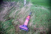 Pollution old Dyson vacuum cleaner dumped in  the countryside