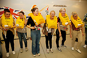 Yellow life jackets are used during this safetly session during which the trainees will inflate a life jacket for the first time, to much amusement. Virgin Atlantic air stewardess and steward training at The Base training facility in Crawley. Potential hostesses are put through a gruelling 6 week training program, during which they are tested to their limits. With exams every day requiring an 88% score to pass. The Base is a modern environment for a state of the art airline training situated next to Virgin Atlantic's HQ.