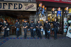 August 26, 2017 - San Francisco, Calif - Police watches the march from stores in the Mission District, some with Trump Pinatas during the scheduled Patriot Prayer event on Saturday, Aug. 26, 2017 in San Francisco, Calif. (Credit Image: © Paul Kuroda via ZUMA Wire)