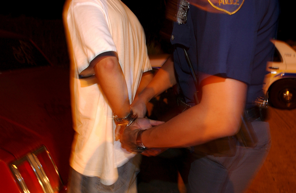 San Antonio, Texas August 7-8, 2003: Police officers in action in south San Antonio, TX. Officers arrest a suspected drug dealer after a late-night chase.  ©Bob Daemmrich/The Image Works