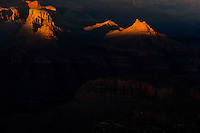 United States, Arizona, Grand Canyon. Sunset at Lipan Point, with sunrays hitting some of the peaks.