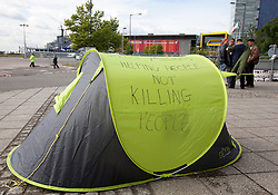 © Licensed to London News Pictures. 10/09/2013. London, UK. A tent bearing a peace slogan belonging to 'Occupy vs the Arms Fair' protesters is seen outside the Defence Security and Equipment International (DSEI) exhibition in London today (10/09/2013). The biennial event, held at the at the Excel Centre in London's Docklands, is one of the world's largest with around 1350 exhibitors from 40 countries across the world. Photo credit: LNP