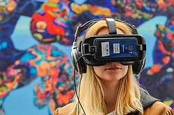 © Licensed to London News Pictures. 20/04/2017. London, UK. A user experiences the latest advancements in virtual and augmented reality at the Virtual Reality Show which opened today at the Business Design Centre in Islington.   Photo credit : Stephen Chung/LNP