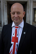 A Union jack tie and political pin portrait of UKIP (UK Independence Party) member from Ayelsbury Vale District council, Cllr Chris Adams.