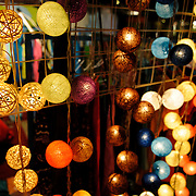 Strings of brightly colored decorate lights for sale at the night market on Quai Fa Ngum on the banks of the Mekong in Vientiane, Laos.