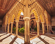 Inside the Alcazar Palace in Seville. This is El Patio del Yeso (The Plaster Patio): This beautiful, ornate garden retains elements of the Almohade architectural style of the Moors from the 12 century.