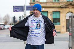 "© Licensed to London News Pictures. 05/02/2018. Liverpool, UK. Supporters of Alfie Evans at Liverpool Civil & Family Court this morning. Tom Evans and Kate James from Liverpool are in dispute with medics looking after their son 19-month-old son Alfie Evans, at Alder Hey Children's Hospital in Liverpool. Alfie is in a ""semi-vegetative state"" and had a degenerative neurological condition doctors have not definitively diagnosed. Specialists at Alder Hey say continuing life-support treatment is not in Alfie's best interests but the boy's parents want permission to fly their son to a hospital in Rome for possible diagnosis and treatment. Photo credit: Andrew McCaren/LNP"