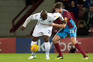 Wycombe Wanderers forward Adebayo Akinfenwa (20)battles with Scunthorpe United defender Cameron Burgess (21) during the EFL Sky Bet League 1 match between Scunthorpe United and Wycombe Wanderers at Glanford Park, Scunthorpe, England on 29 December 2018.