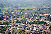 Suffolk square regency architecture (lower left) in aerial view of tree lined streets of Cheltenham Spa Town seen from Leckhampton Hill
