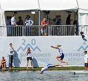Bled, SLOVENIA. GBR W2X. Bow Anna WATKINS and Katherine GRAINGER, Gold medalist Women's double sculls final at the  2011 FISA World Rowing Championships, Lake Bled. Saturday  03/09/2011. Taking a swim before the medal ceremony.   [Mandatory Credit; Peter Spurrier/ Intersport Images]