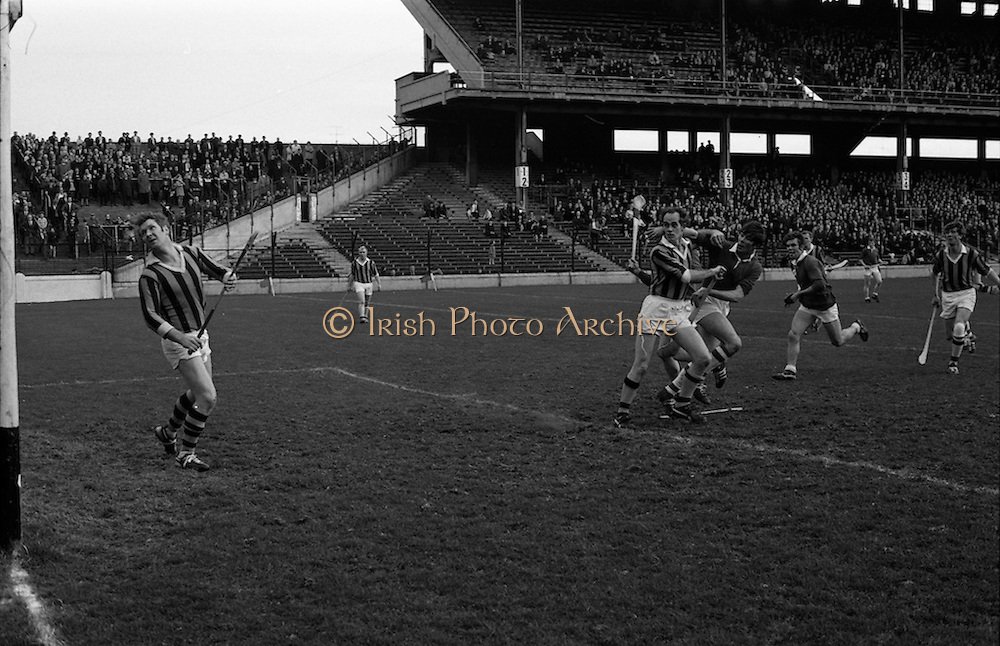 02/11/1969<br /> 11/02/1969<br /> 2 November 1969<br /> Oireachtas Hurling Final: Cork v Kilkenny at Croke Park, Dublin.<br /> E. O'Brien, the Cork forward, being tackled by T. Carrall (one of the Kilkenny backs) after he hit the ball into the net for Cork's third goal.