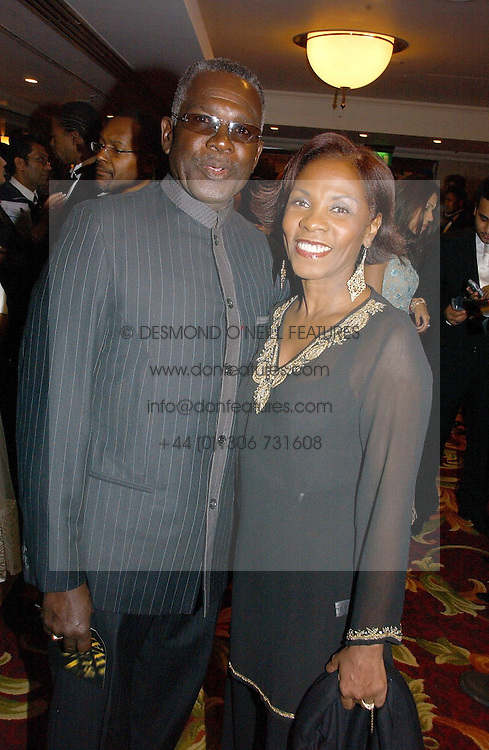 Actor RUDOLPH WALKER and his wife  at the 10th Anniversary Asian Business Awards 2006 at the London Grosvenor Hotel Park Lane, London on 19th April 2006.<br /><br />NON EXCLUSIVE - WORLD RIGHTS