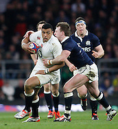 Luther Burrell of England (L) is tackled by Stuart Hogg of Scotland during the RBS 6 Nations match at Twickenham Stadium, Twickenham<br /> Picture by Andrew Tobin/Focus Images Ltd +44 7710 761829<br /> 14/03/2015