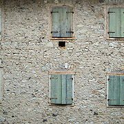 LONGARONE, ITALY - SEPTEMBER 26:  Empty houses and closed windows are seen in Erto that was partially destroyed by the Vajont landslide on  September 26, 2013 in Longarone, Italy. The Vajont  tragedy happened on the night of the 9th October 1963, when a landslide broke away from Mount Toc and fell into the Vajont river causing a wave that struck the neighboring towns, the devastation was total, more than 2000 people died and only few lucky villagers survived.  (Photo by Marco Secchi/Getty Images)