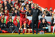Trent Alexander-Arnold of Liverpool takes a throw in while Liverpool Manager Jurgen Klopp looks on. Premier League match, Liverpool v Burnley at the Anfield stadium in Liverpool, Merseyside on Saturday 16th September 2017.<br /> pic by Chris Stading, Andrew Orchard sports photography.