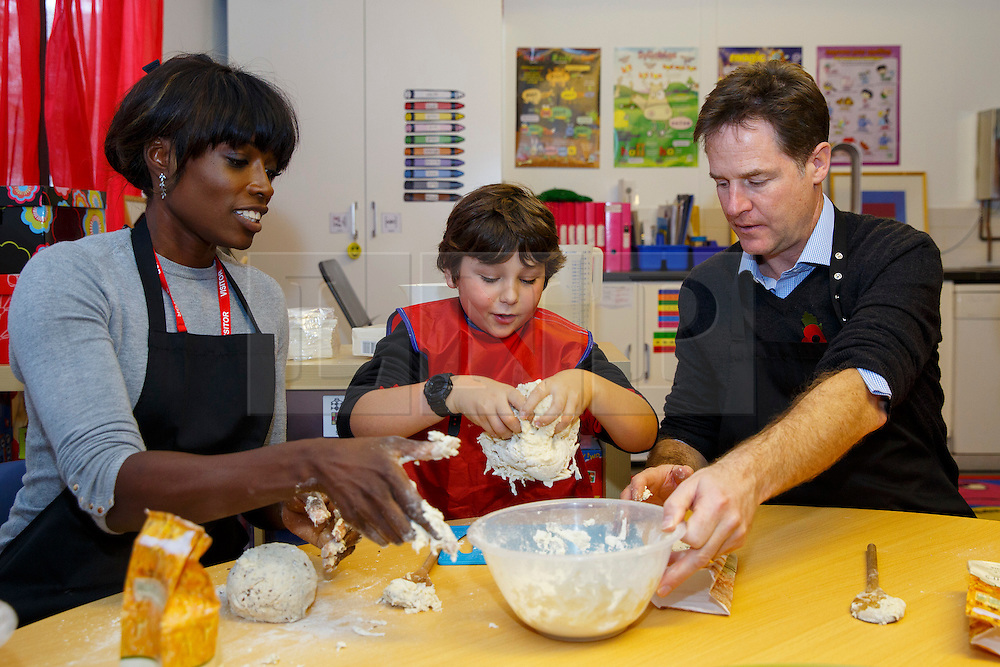 © Licensed to London News Pictures. 03/11/2014. LONDON, UK. Lorraine Pascale and Deputy Prime Minister Nick Clegg participate in a bread making lesson at Weston Park Primary School in Crouch End, London on Monday 3 November 2014. Photo credit : Tolga Akmen/LNP