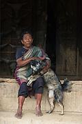Chang Naga woman & dog<br /> Chang Naga headhunting Tribe<br /> Tuensang district<br /> Nagaland,  ne India