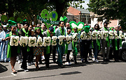 Commemoration of the first anniversary of the devastating fire of 14th/15th June  2017 in Grenfell Tower, Lancaster West Estate, West London, United Kingdom when 72 people were killed. After a 72 second silence one second for each victim survivors and family members held a silent walk to the tower, behind people holding white flowers spelling out Humanity for Grenfell.