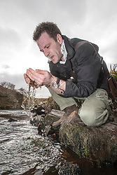Historian Ashley Cowie looking for gold flakes in the River Thurso. at the 'The Devil's Gold' in Dirlot, Caithness. He is doing a seven part series for The Scottish Sun on Scotland's treasure hunts at the end of April..©Michael Schofield.
