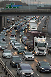 © Licensed to London News Pictures. 27/12/2014.  There are long delays on the M25 between Junctions 4 and 31 with many miles of tail backs. Traffic is seen here on the M25 approaching the Dartford Crossing. This is just one of the traffic hotspots around the country's motorway network today. Credit : Rob Powell/LNP