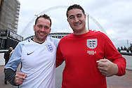 two  England fans pose outside Wembley Stadium before k/o. FIFA World cup qualifying match, european group F, England v Malta at Wembley Stadium in London on Saturday 8th October 2016.<br /> pic by John Patrick Fletcher, Andrew Orchard sports photography.