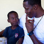 Dwight Howard plays with a youngster at a school during his recent trip to the island to promote the Dwight Howard Fund.  Mandatory Credit: Alex Menendez Dwight Howard in Haiti after the 2010 earthquake for the D12 Foundation relief fund.