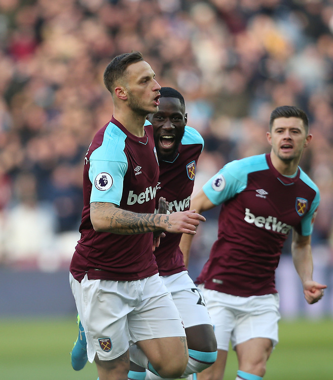 West Ham United's Marko Arnautovic celebrates scoring his side's first goal with Arthur Masuaku and Aaron Cresswell<br /> <br /> Photographer Rob Newell/CameraSport<br /> <br /> The Premier League - West Ham United v Chelsea - Saturday 9th December 2017 - London Stadium - London<br /> <br /> World Copyright © 2017 CameraSport. All rights reserved. 43 Linden Ave. Countesthorpe. Leicester. England. LE8 5PG - Tel: +44 (0) 116 277 4147 - admin@camerasport.com - www.camerasport.com