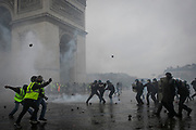 French yellow vests clash with the police during mass protests in Paris.