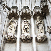 Statues on the front of the Cathedral of St. Michael and St. Gudula (in French, Co-Cathédrale collégiale des Ss-Michel et Gudule). A church was founded on this site in the 11th century but the current building dates to the 13th to 15th centuries. The Roman Catholic cathedral is the venue for many state functions such as coronations, royal weddings, and state funerals. It has two patron saints, St Michael and St Gudula, both of whom are also the patron saints of Brussels.