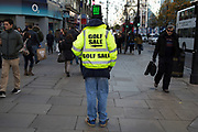 Golf sale advertising man standing on Oxford Street, London, UK.