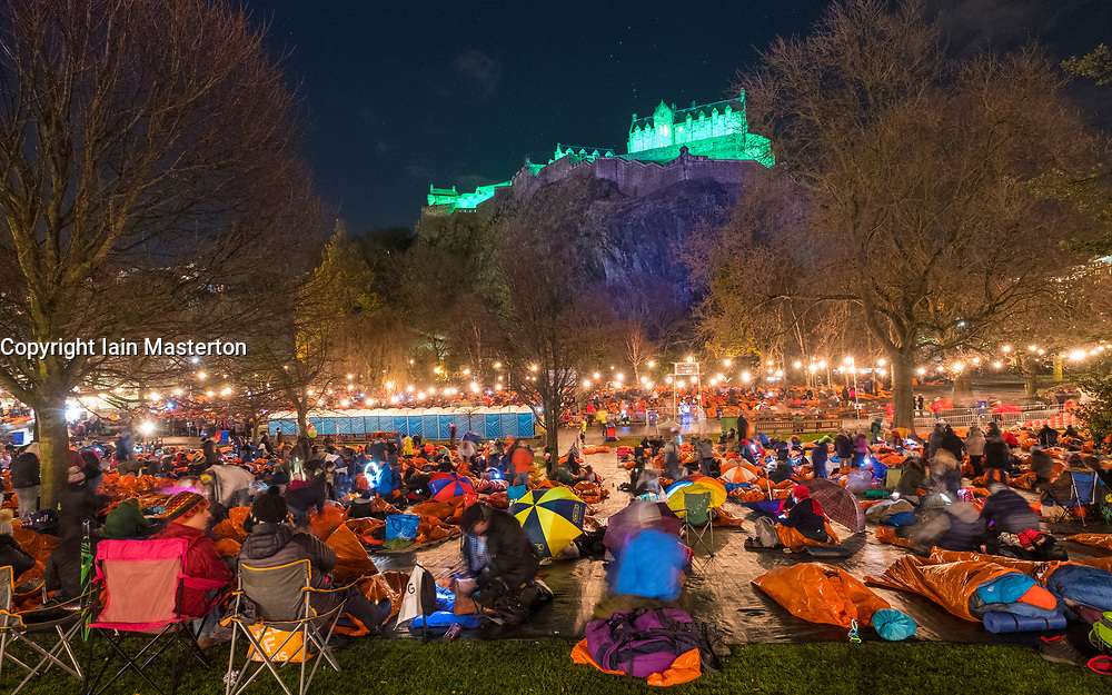 Edinburgh, United Kingdom. 9 December,2017. Sleep in the Park, held in Princes Street Gardens in Edinburgh, will see almost 9000 people sleep outdoors to raise money and awareness of homelessness. Participants bedding down for the night in survival bags in freezing temperatures beneath Edinburgh Castle.
