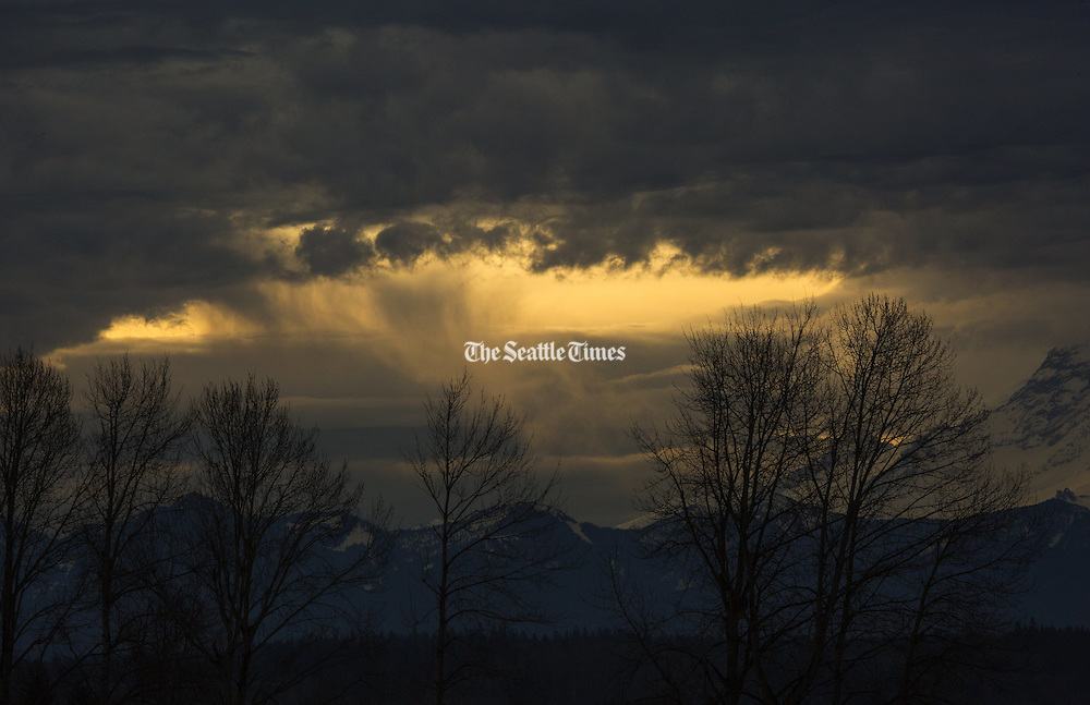 A patch of sunshine bursts through the clouds over the Kent Valley. (Ellen M. Banner / The Seattle Times)