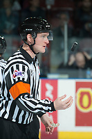 KELOWNA, CANADA - APRIL 25: Referee Brett Iverson tosses the puck at centre ice between the Kelowna Rockets and the Seattle Thunderbirds on April 25, 2017 at Prospera Place in Kelowna, British Columbia, Canada.  (Photo by Marissa Baecker/Shoot the Breeze)  *** Local Caption ***