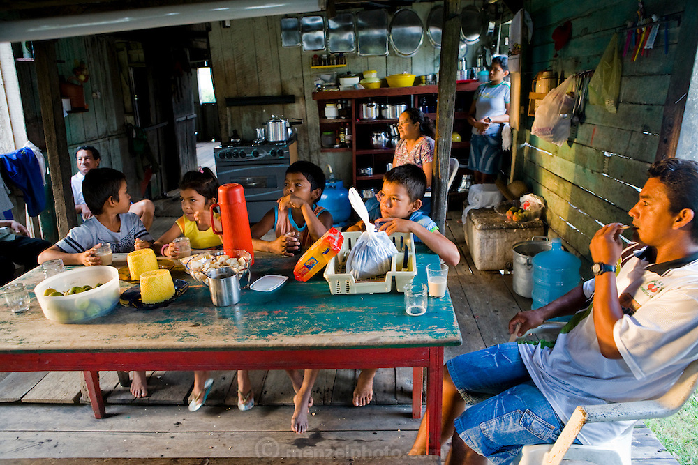 Breakfast before a school day at the riverside home of Solange and Francisco da Silva Correia near the town of Caviana, Amazonas, Brazil. (Solange Da Silva Correia is featured in the book What I Eat: Around the World in 80 Diets.)